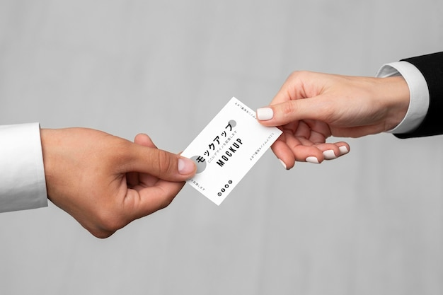 Men holding a business card mock-up
