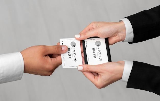 Men holding business cards mock-up