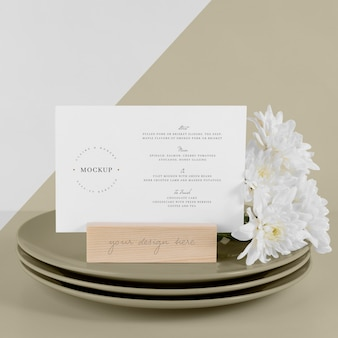 Menu mock-up with dishes and white flowers