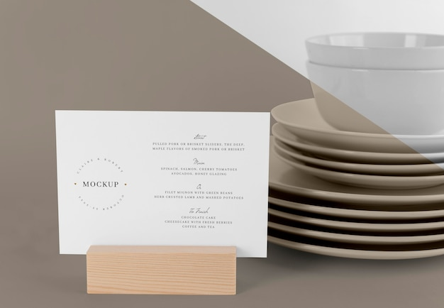 Menu mock-up with wooden stand and dishes