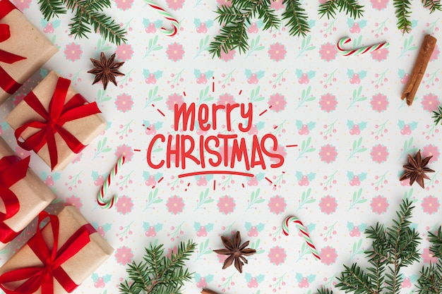 Merry christmas on floral background top view