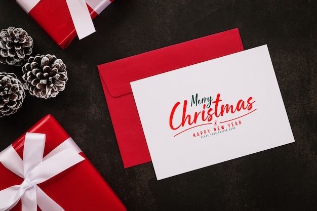 Merry christmas greeting card and envelope mockup with christmas gifts decorations
