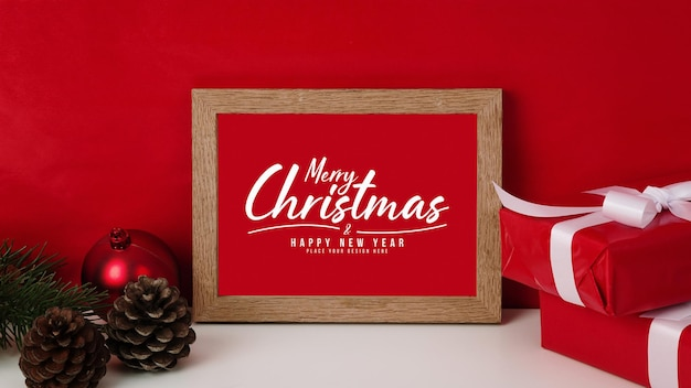 Merry christmas greeting card in frame mockup with christmas gifts decorations