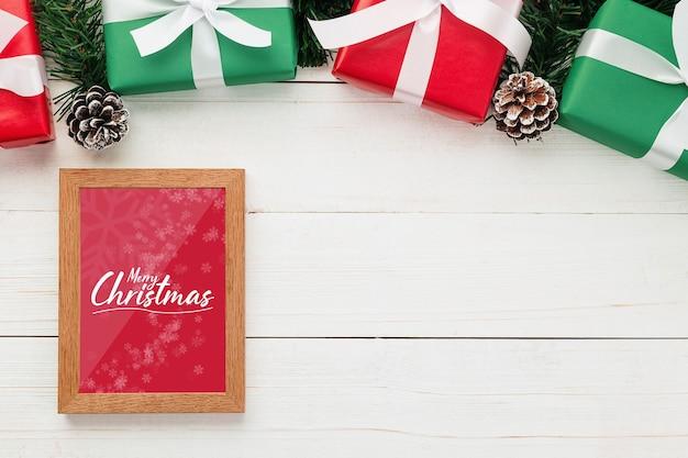 Merry christmas greeting card and frame mockup