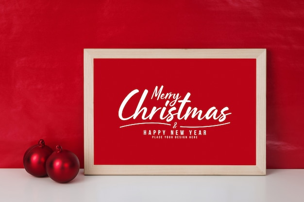Merry christmas greeting card in frame mockup