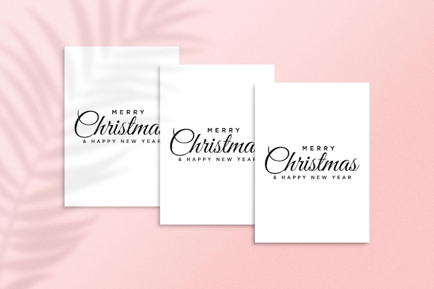 Merry christmas greeting card mockup psd with palm leaves shadow