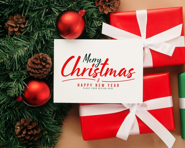 Merry christmas greeting card mockup with christmas gifts decorations