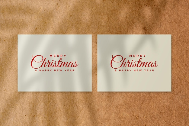 Merry christmas greeting card mockup with palm leaves shadow