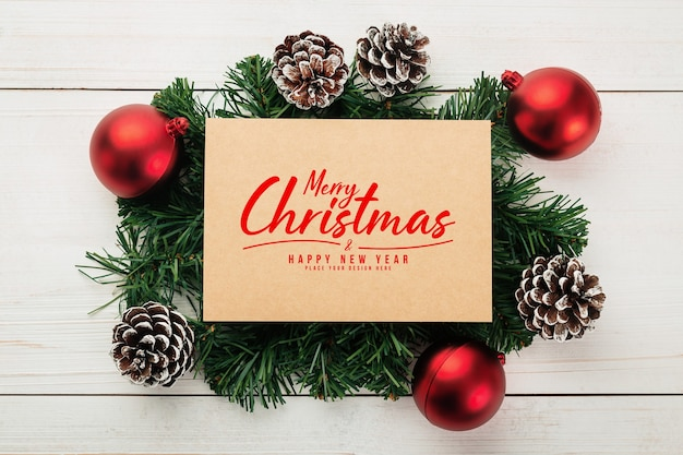 Merry christmas greeting card mockup with pine leaves decorations
