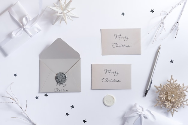 Merry christmas greeting card mockups and envelope