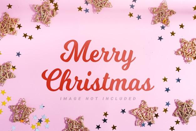 Поздравительная открытка с рождеством и звездами и ярким конфетти.