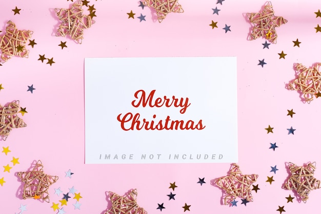 Merry christmas greeting card with stars and bright confetti decoration
