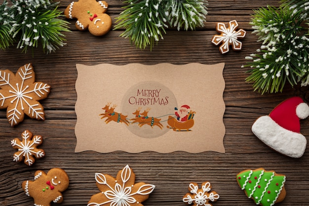 Merry christmas mock-up and candies and christmas pine leaves