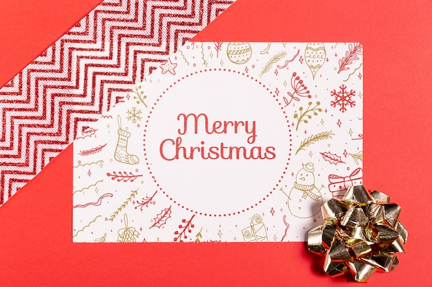 Merry christmas mock-up paper with bow and ribbon