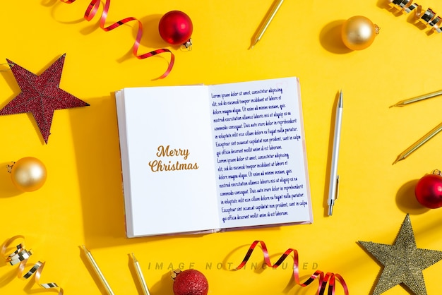 Merry christmas mockup notebook and holiday decoration.