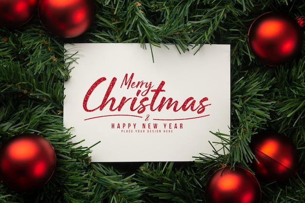 Merry christmas paper note mockup with pine leaves decorations