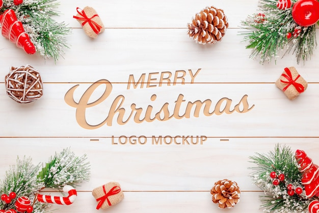 Merry christmas text or logo mockup on wooden desk