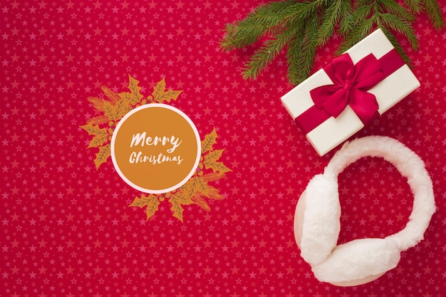 Merry christmas with gifts on christmas red background