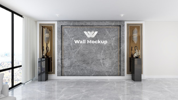 Металлический логотип на макете комнаты администратора офиса