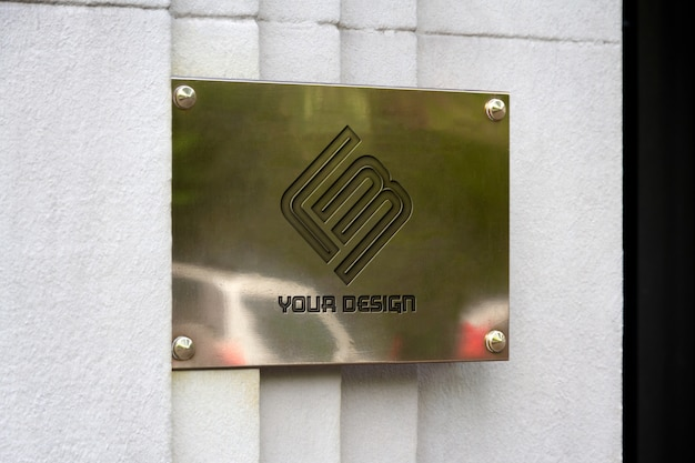 Metallic sign on wall mockup