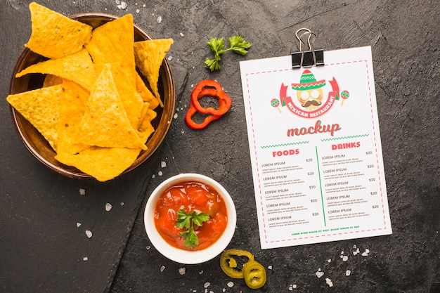 Mexican menu next to tortilla chips and sauce