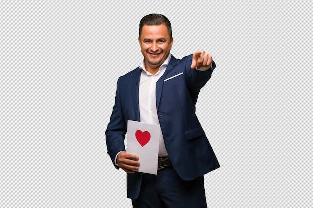 Middle aged latin man celebrating valentines day cheerful and smiling