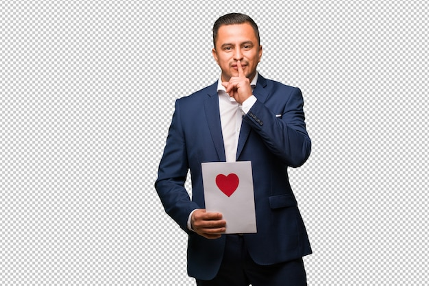 Middle aged latin man celebrating valentines day keeping a secret or asking for silence
