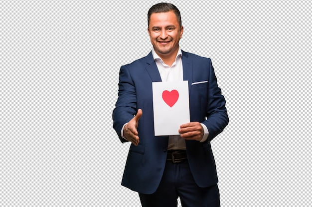 Middle aged latin man celebrating valentines day reaching out to greet someone