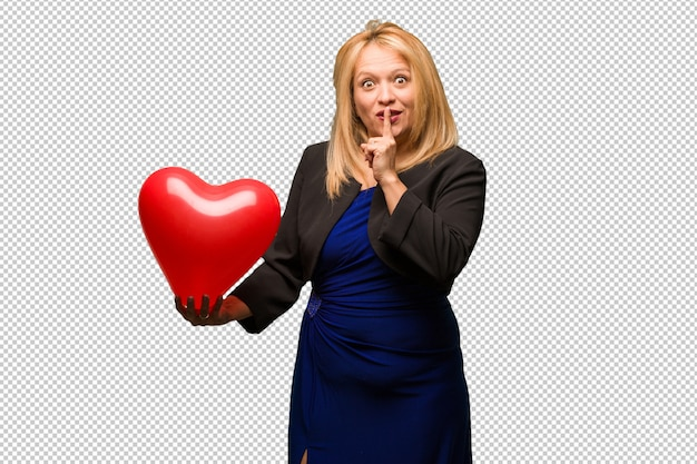 Middle aged latin woman celebrating valentines day keeping a secret or asking for silence