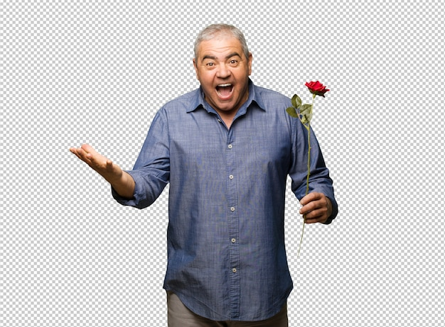 Middle aged man celebrating valentines day celebrating a victory or success