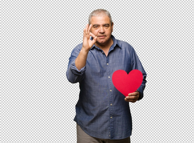 Middle aged man celebrating valentines day cheerful and confident doing ok gesture