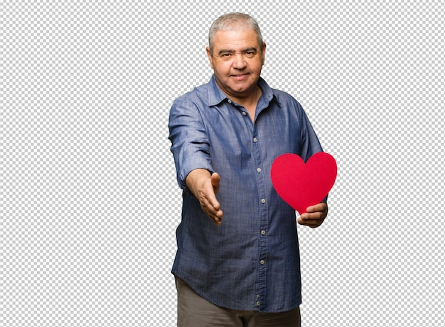 Middle aged man celebrating valentines day reaching out to greet someone