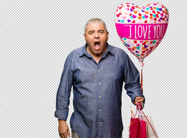 Middle aged man celebrating valentines day screaming very angry and aggressive