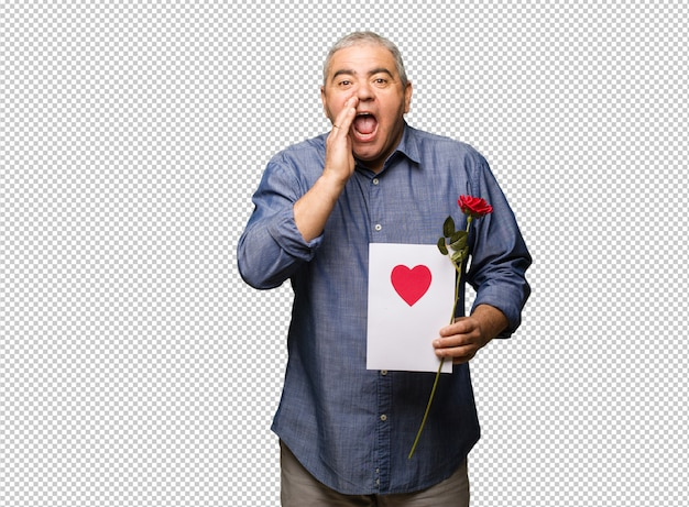 Middle aged man celebrating valentines day shouting something happy to the front