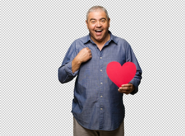 Middle aged man celebrating valentines day surprised, feels successful and prosperous
