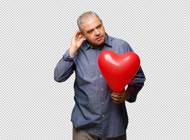 Middle aged man celebrating valentines day try to listening a gossip