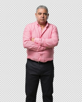 Middle aged man crossing his arms, serious and imposing, feeling confident and showing power
