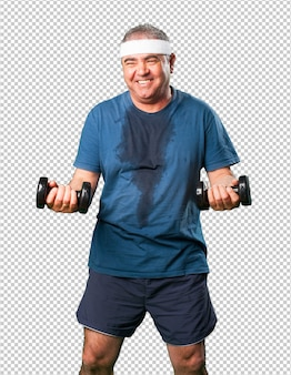 Middle aged man doing exercise with dumbbells