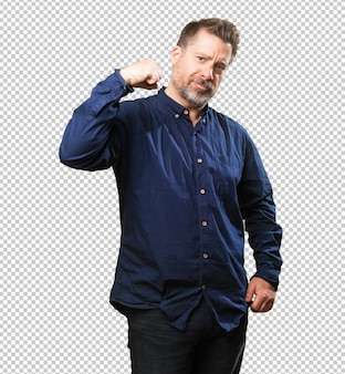 Middle aged man doing a power gesture