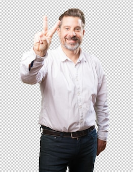 Middle aged man doing a victory gesture