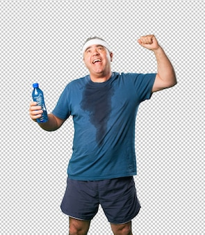 Middle aged man doing winner gesture