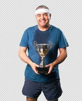 Middle aged man holding a trophy