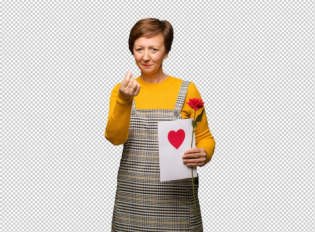 Middle aged woman celebrating valentines day doing a gesture of need