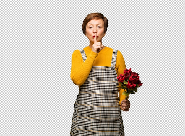 Middle aged woman celebrating valentines day keeping a secret or asking for silence