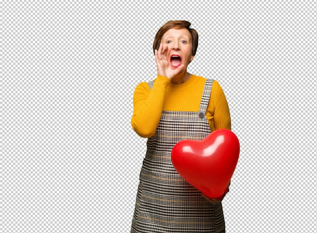 Middle aged woman celebrating valentines day shouting something happy to the front
