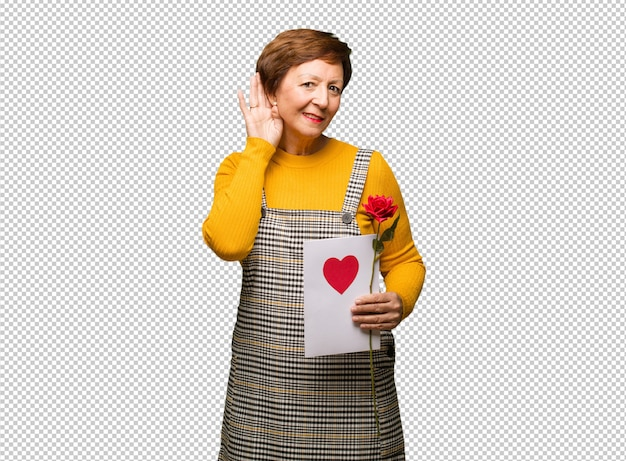 Middle aged woman celebrating valentines day try to listening a gossip