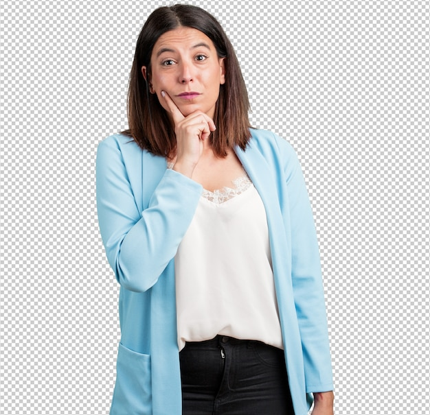 Middle aged woman doubting and confused, thinking of an idea or worried about something