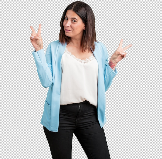 Middle aged woman fun and happy, positive and natural, makes a gesture of victory, peace concept