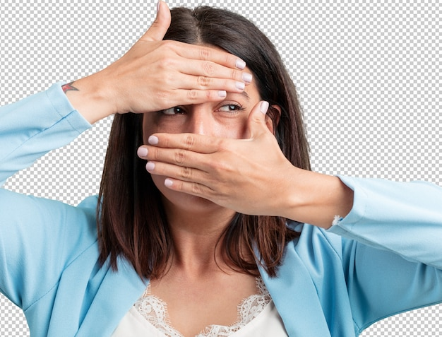 Middle aged woman looking through a gap, hiding and squinting