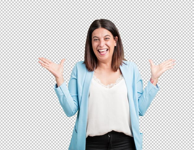 Middle aged woman screaming happy, surprised by an offer or a promotion, gaping, jumping and proud